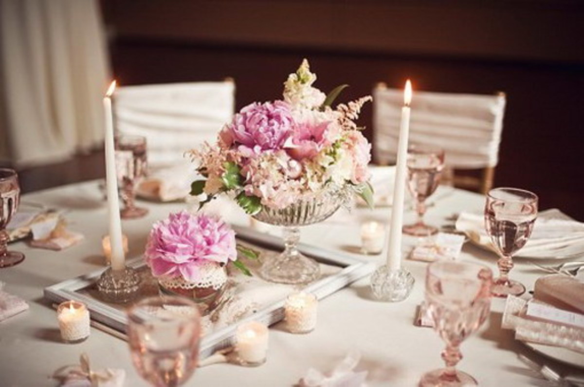 lovely round table pink flower arrangement