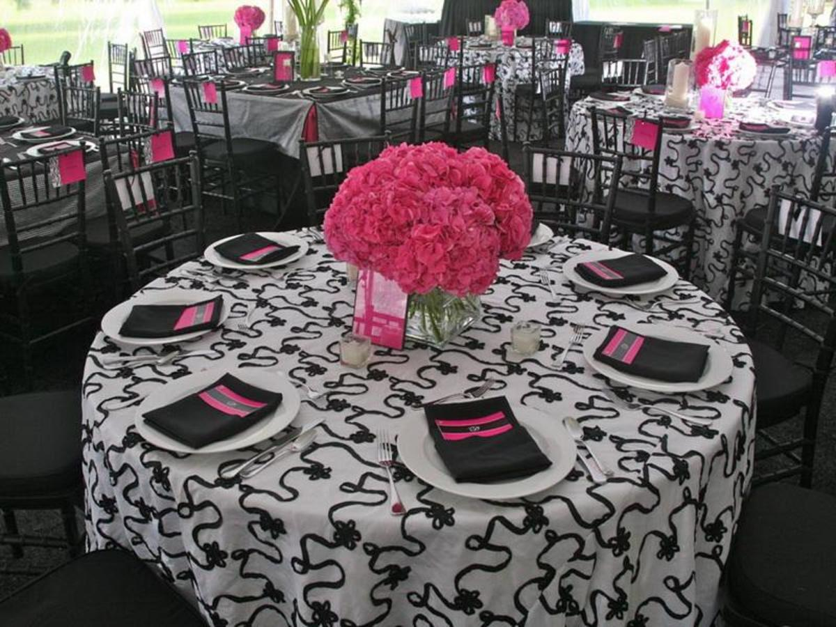 Printed black and white tablecloth with gorgeous hot pink flower centerpiece