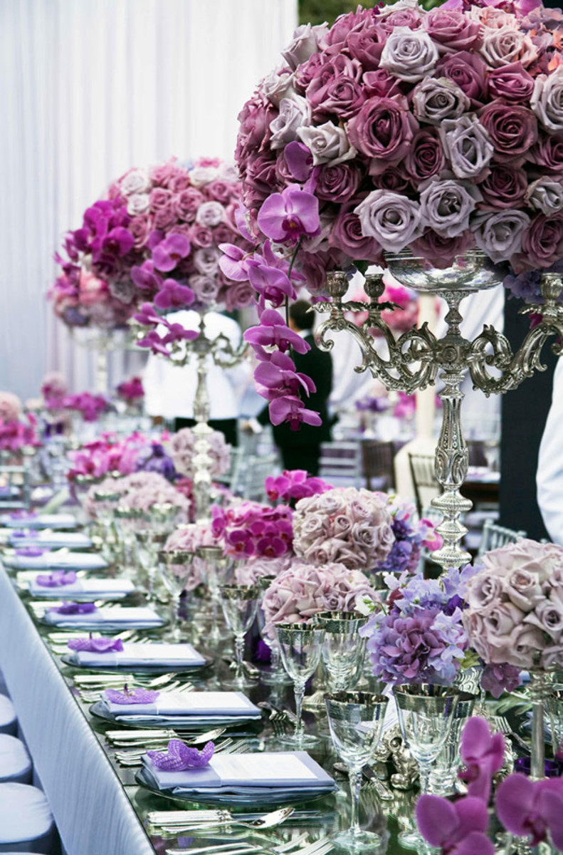 Day time wedding table adornment with overdose of gorgeous fresh flower arrangement