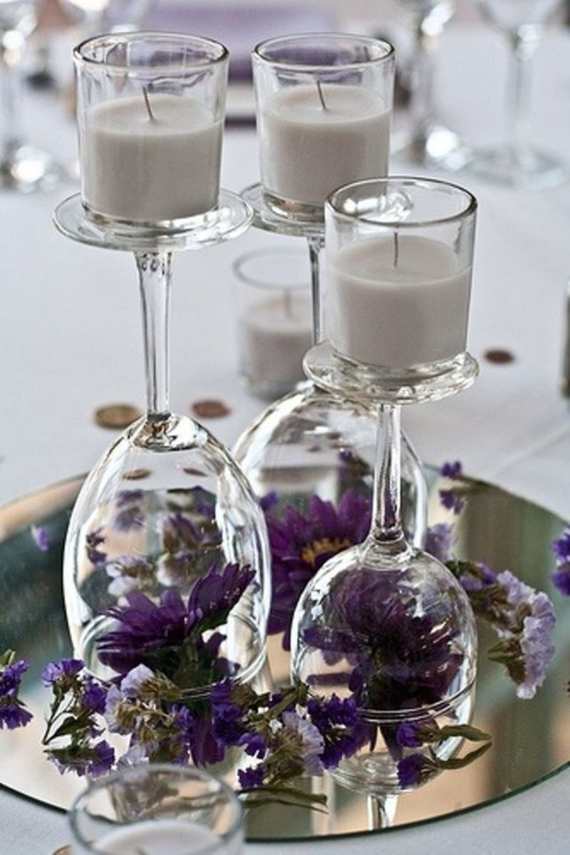 upside down glass decoration piece with candles and purple flower