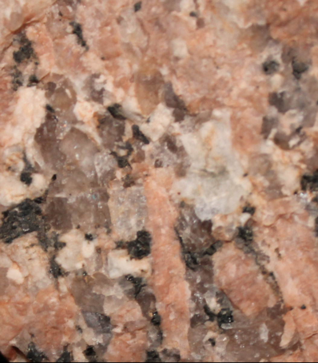 Major Granitic Minerals in the Enchanted Rock: Grey-Quartz...     Pink-Orthoclase...    White- Plagioclase... Black-Hornblende