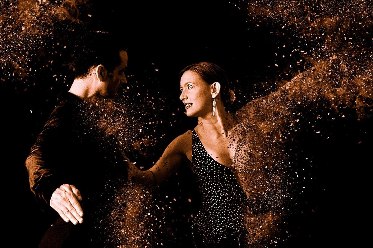 A couple dancing to a ballroom favorite ...the Tango.l