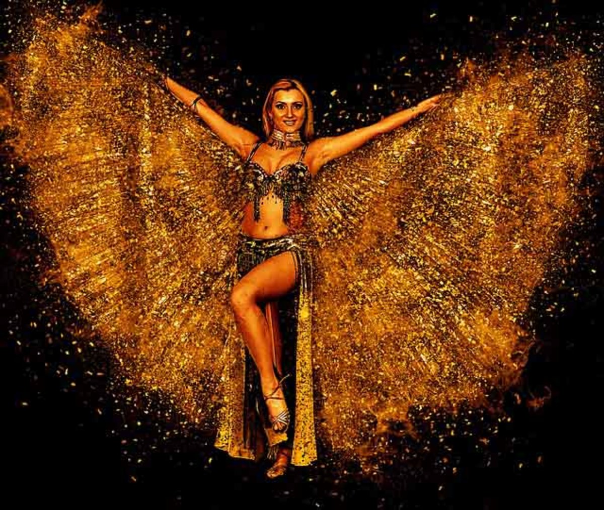 A belly dancer performing with Isis Wings.