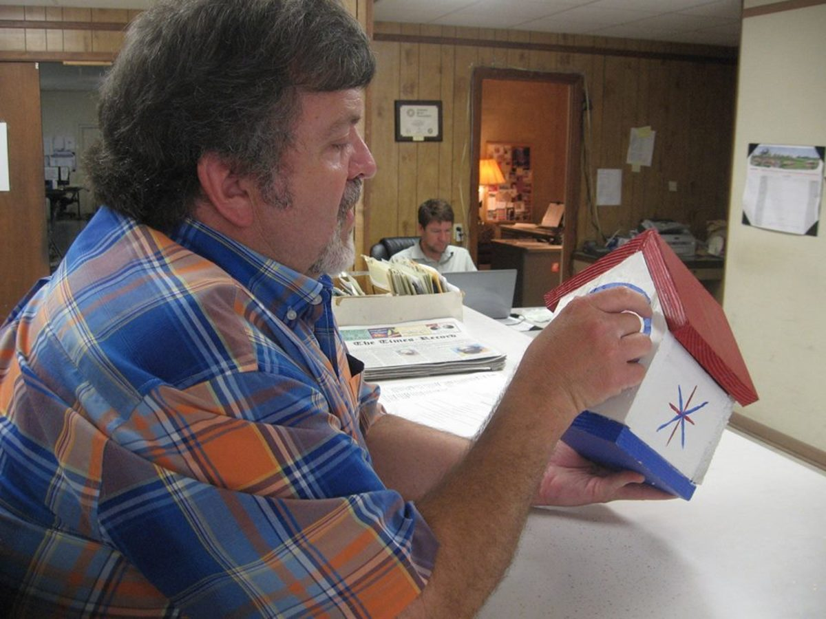 This is my dear friend, Les Walters, who is the managing editor of the Journal Record, our local paper. I've known Walters since 1979. He requested a Capt. America birdhouse and my wife, Pam delivered it.