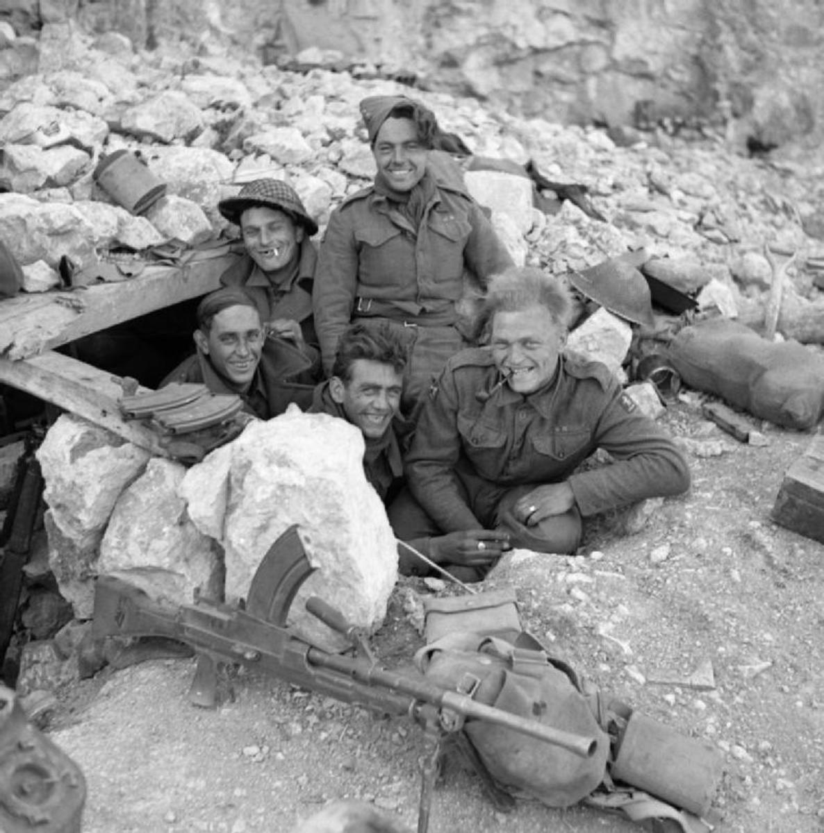 Men of the Royal West Kents hold a dugout on Monastery Hill - their regimental comrades in N E India (overlooking Burma) had it far worse