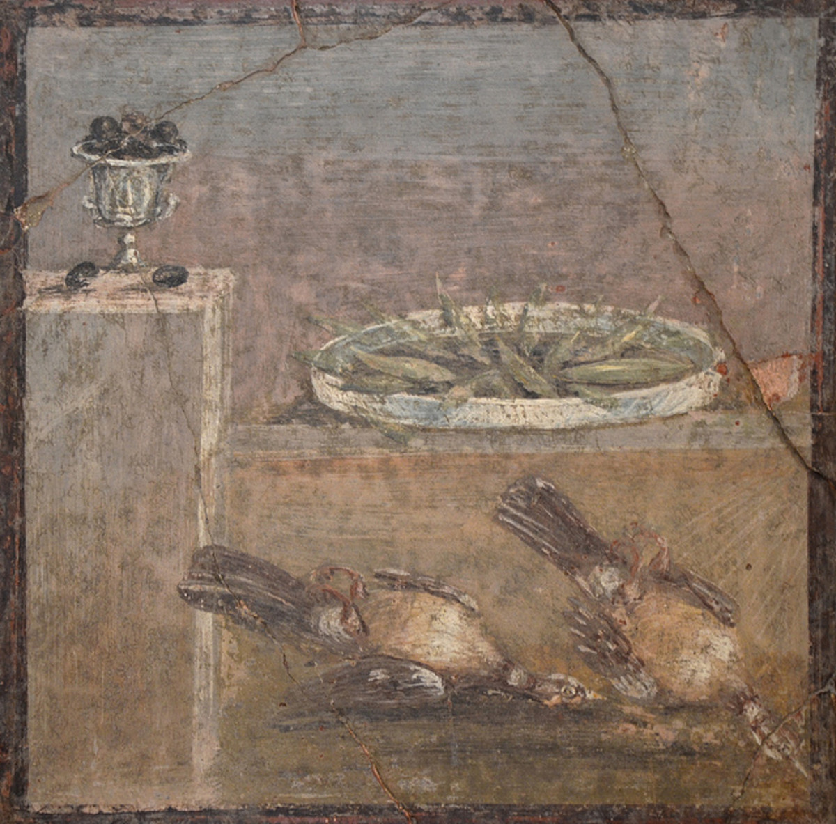 An ancient Roman fresco portraying foods, a cup of olives among them