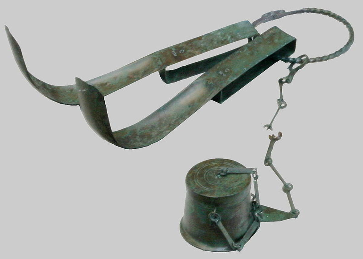 Olive flask and strigil, tools used for bathing in ancient Rome