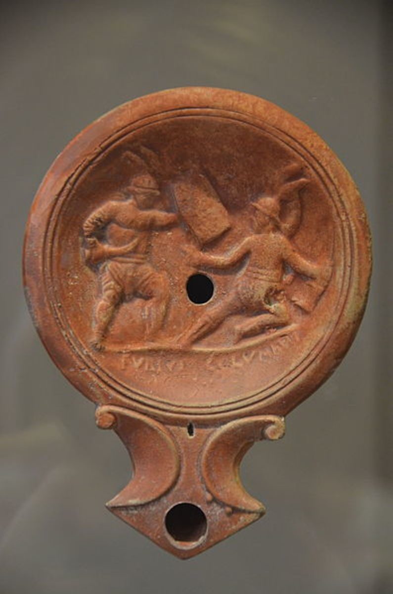 Oil lamp with gladiator decoration on it