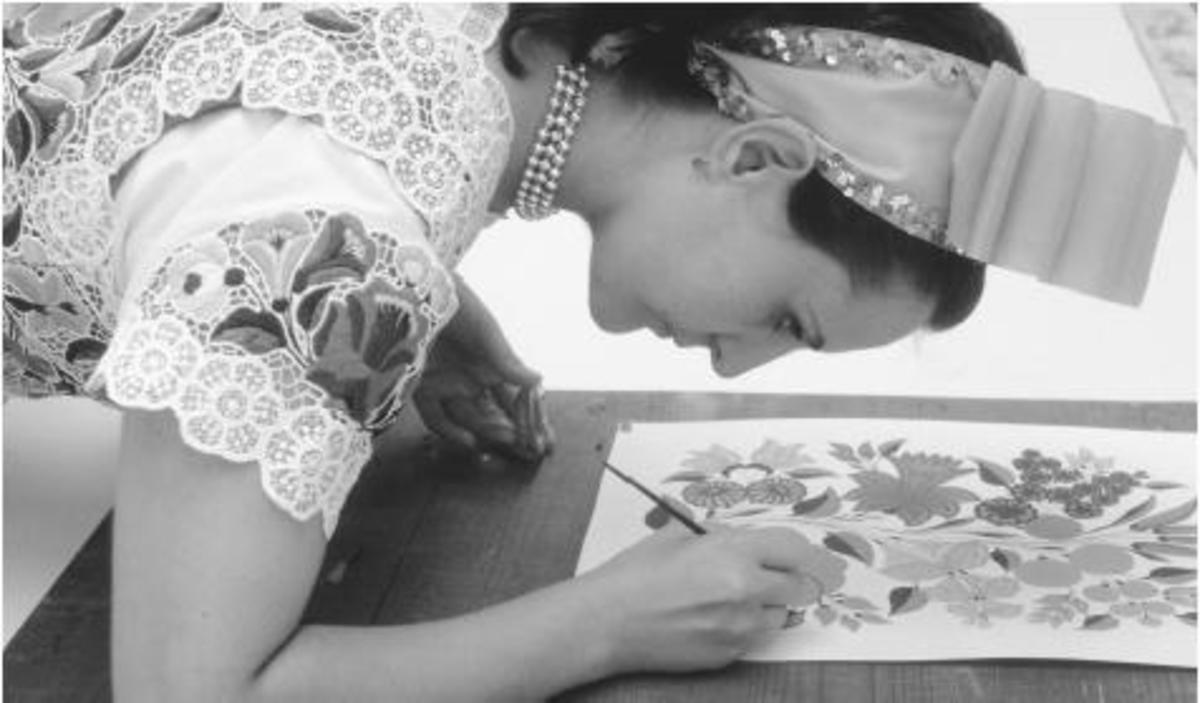 """Writing woman"" painting a design for embroiderers"