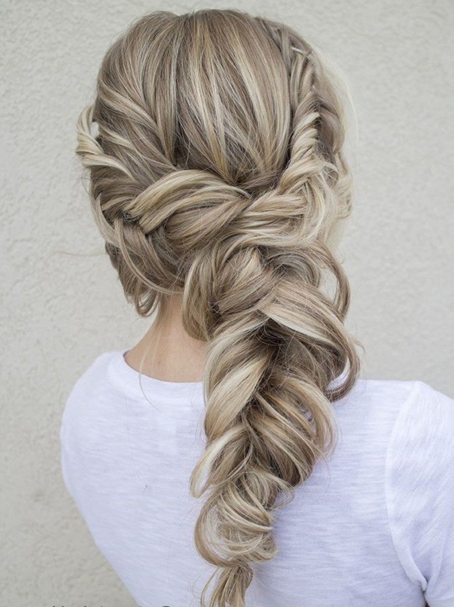 ash blonde hair with thick fluffy braid photo