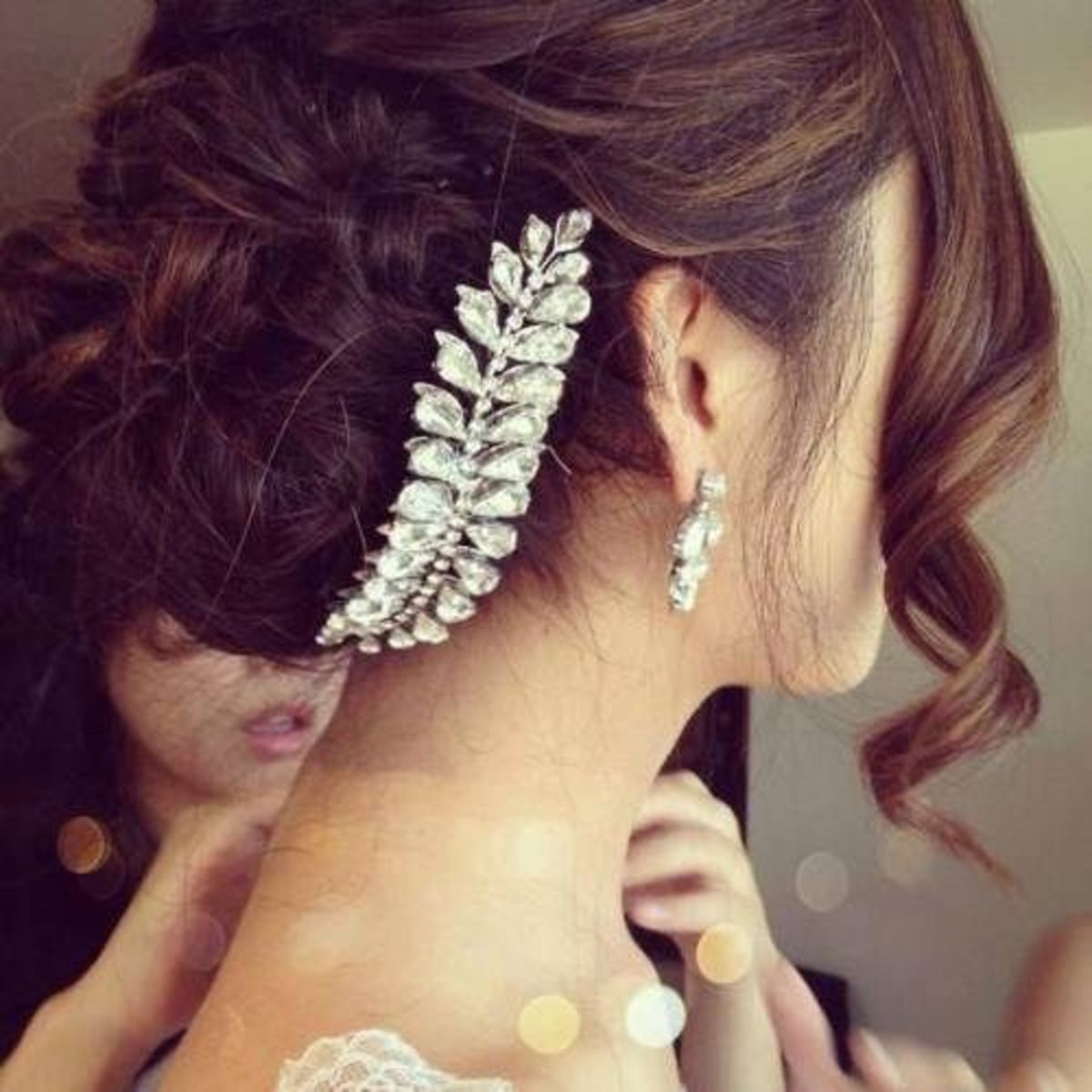 beautful hair bun with below the bun stone jewellery perfect for a wedding look