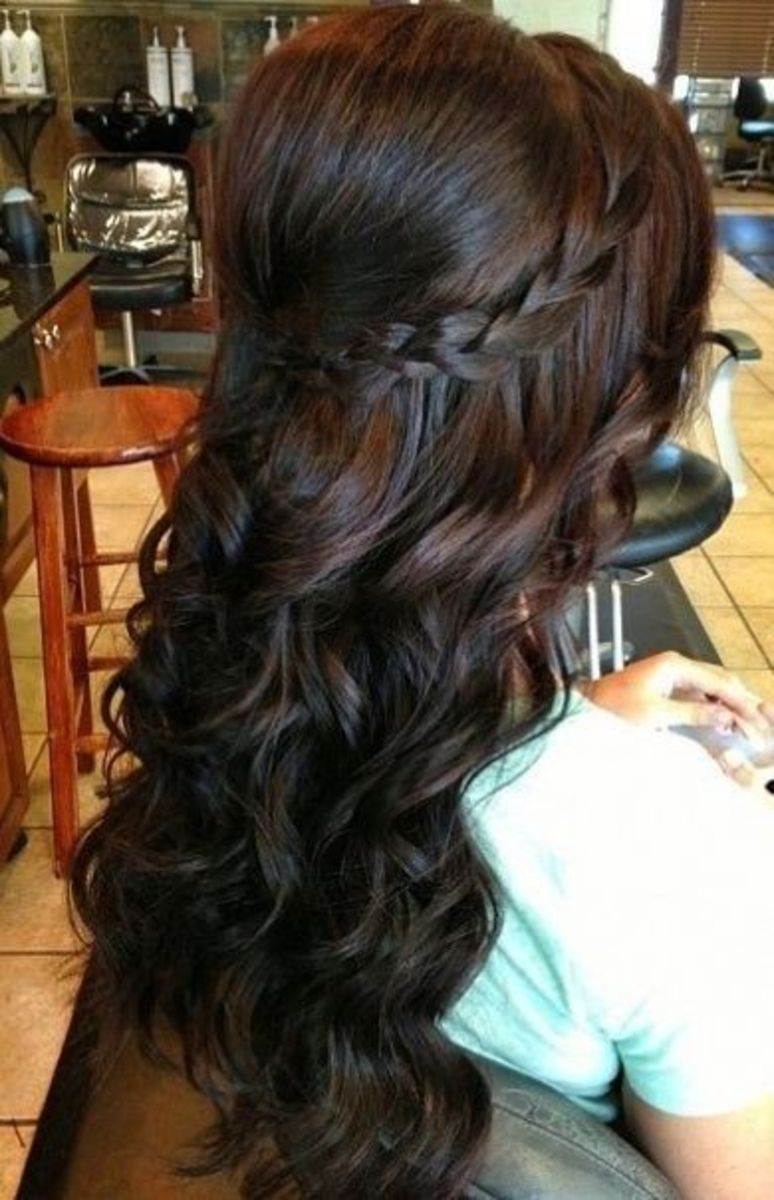 dark brown hair let loose with a single narrow braid circling the crown