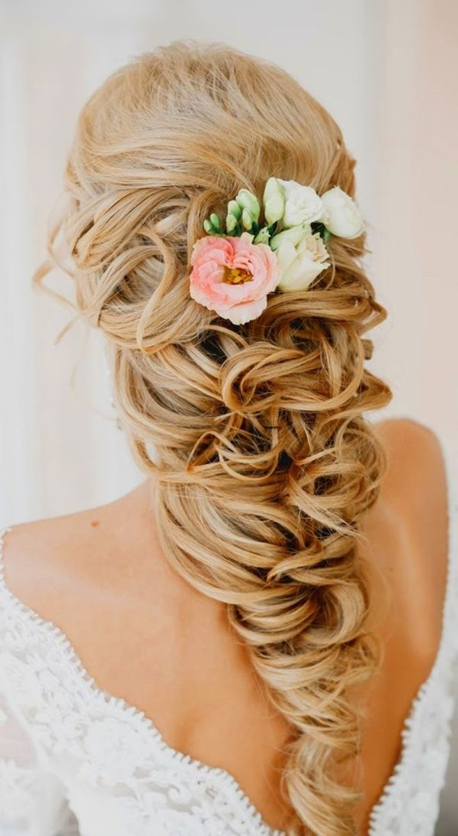 blonde hair braid with pink and white flower planted at the back crown of the head.