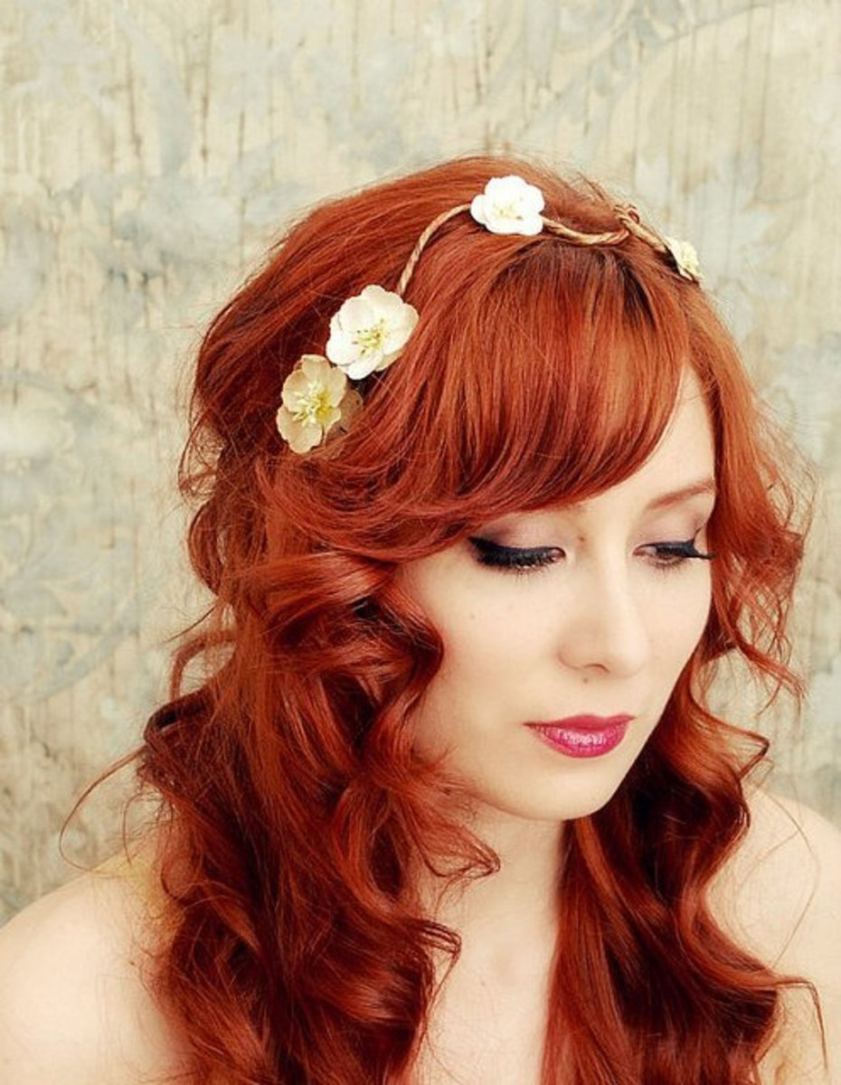 orange red bridal hair set loose with curls and decorated with flower accessory