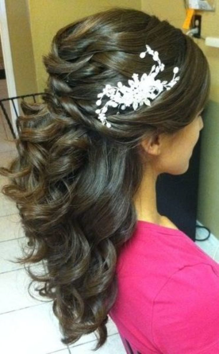 stone hair accessory on curly loose hair on bride