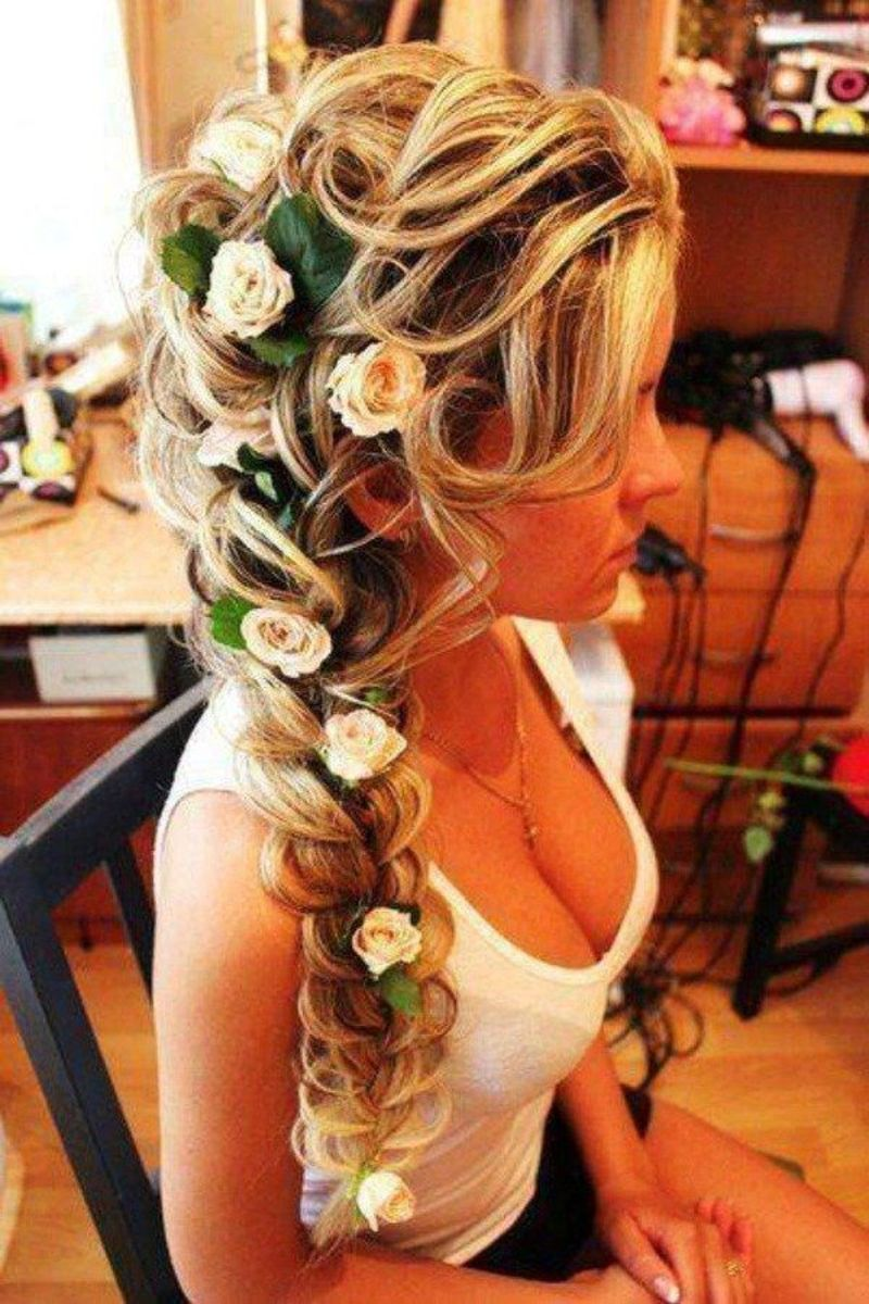 beach blonde hair with braid hairstyle with flower decoration