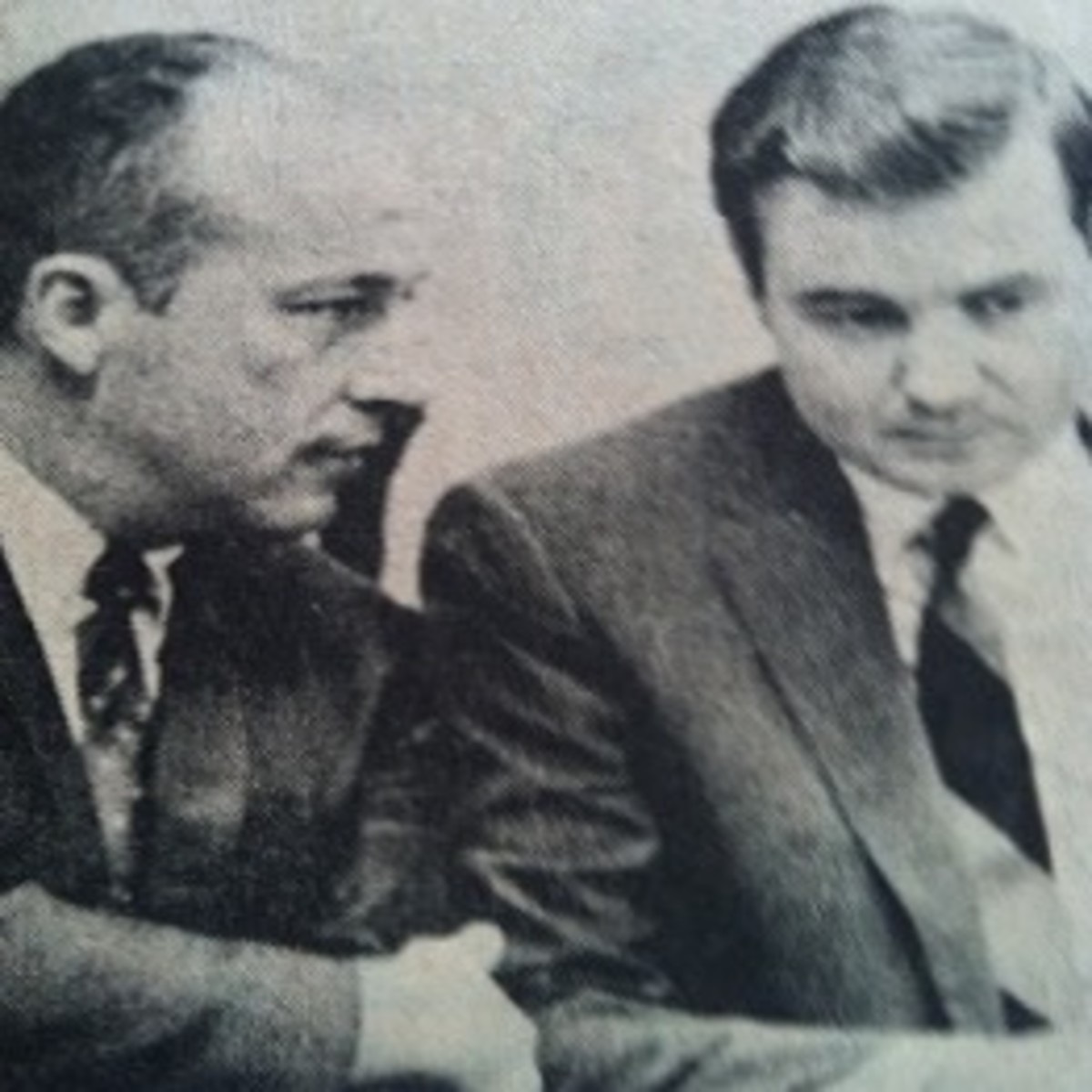 Herman Taylor, Jr. (left) conversing with his attorney, Bernard K. Smith