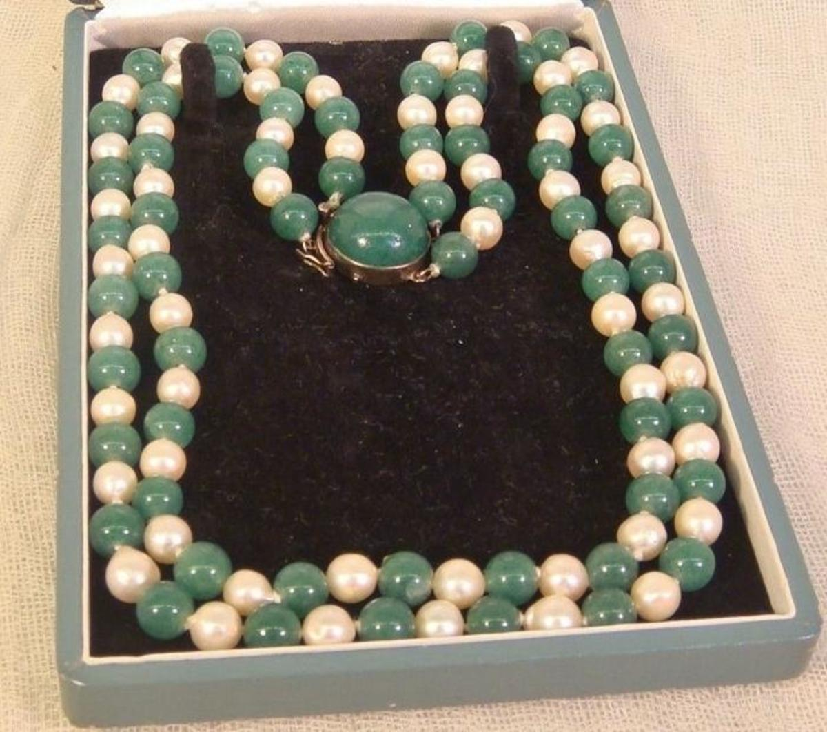This Japanese vintage cultured pearl and jade double strand necklace would date to the early side of the 20th century between 1920's and 1952, when this silver marked was used.