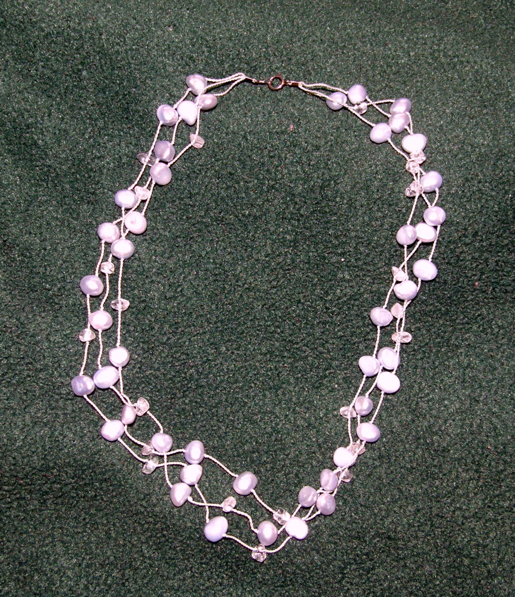 Enhanced irregular sea-blue pearls with aquamarine
