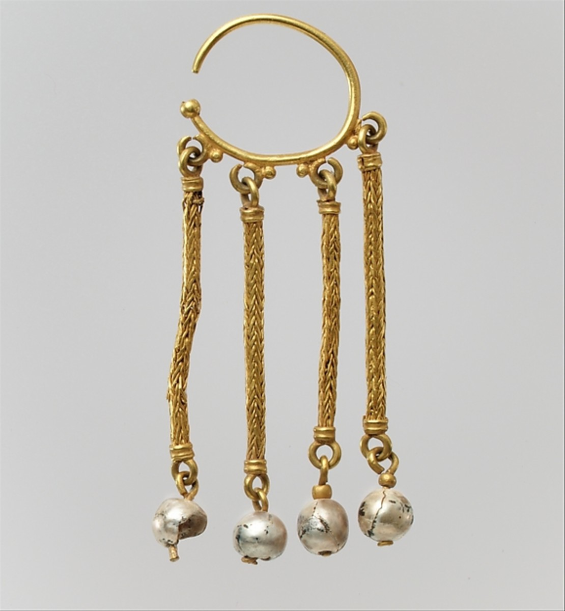 Date:	Between 6th and 7th century Medium:	Gold, pearls Location:	The Met Fifth Avenue in Gallery 302