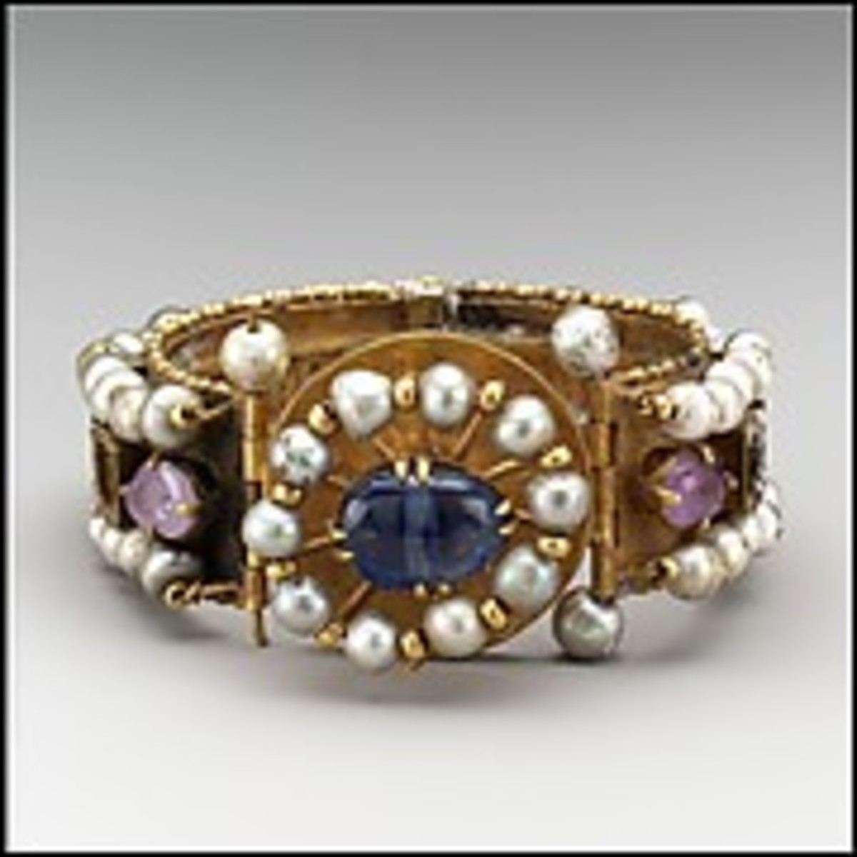 Date:	between 500 and 700 Medium:	Gold, silver, pearls, amethyst, sapphire, glass, quartz Location:	The Met Fifth Avenue in Gallery 302
