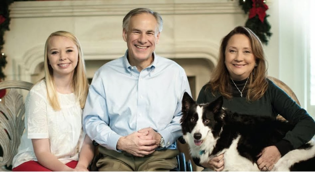 Texas Governor Greg Abbott , wife Cecilia, and daughter Audrey with family dog.