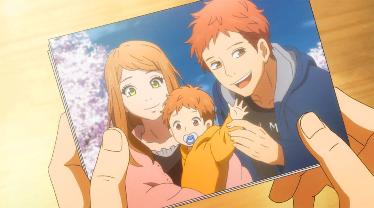 Suwa, Naho and their child.