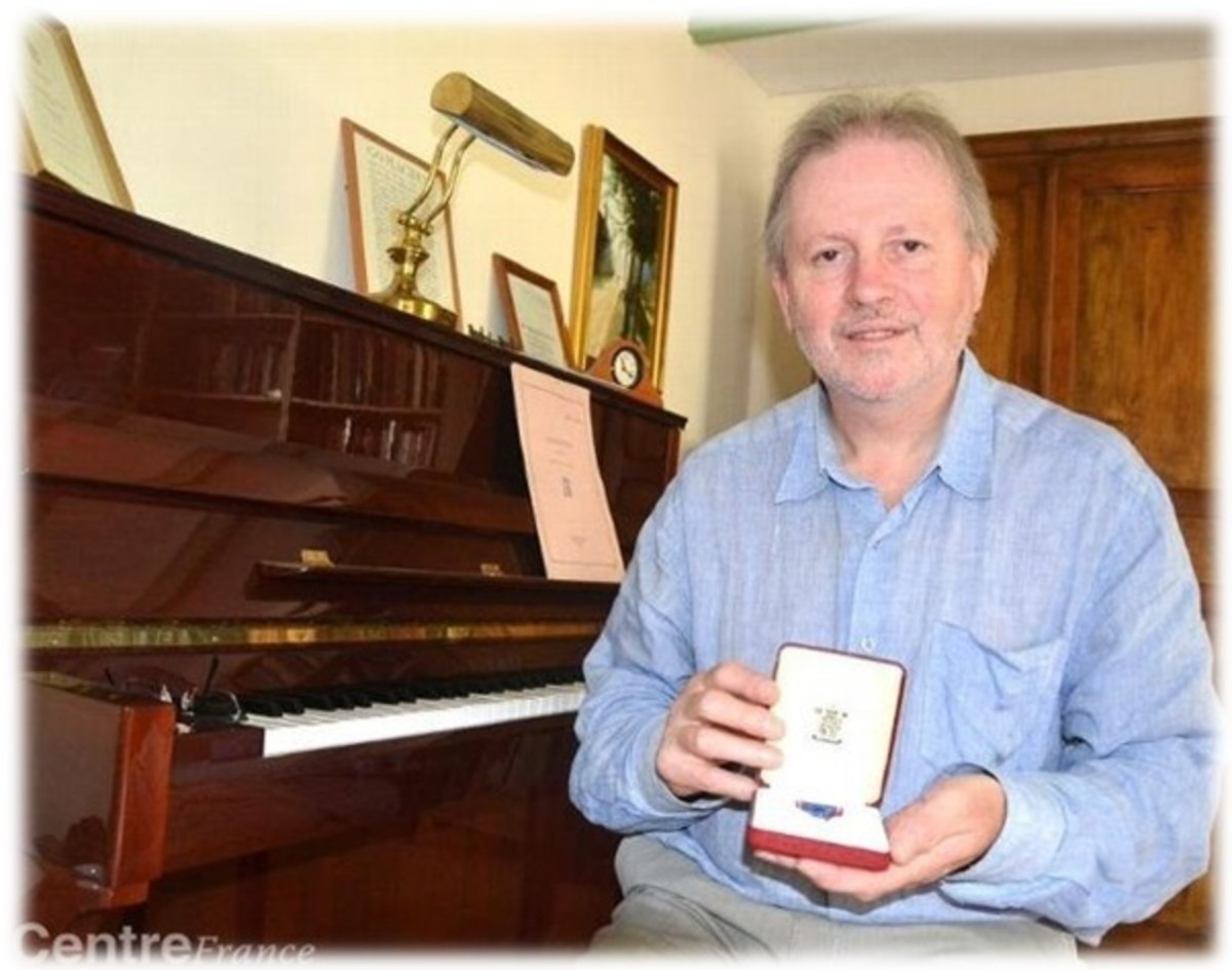 Colin with his Royal Victorian Order award for services to music.