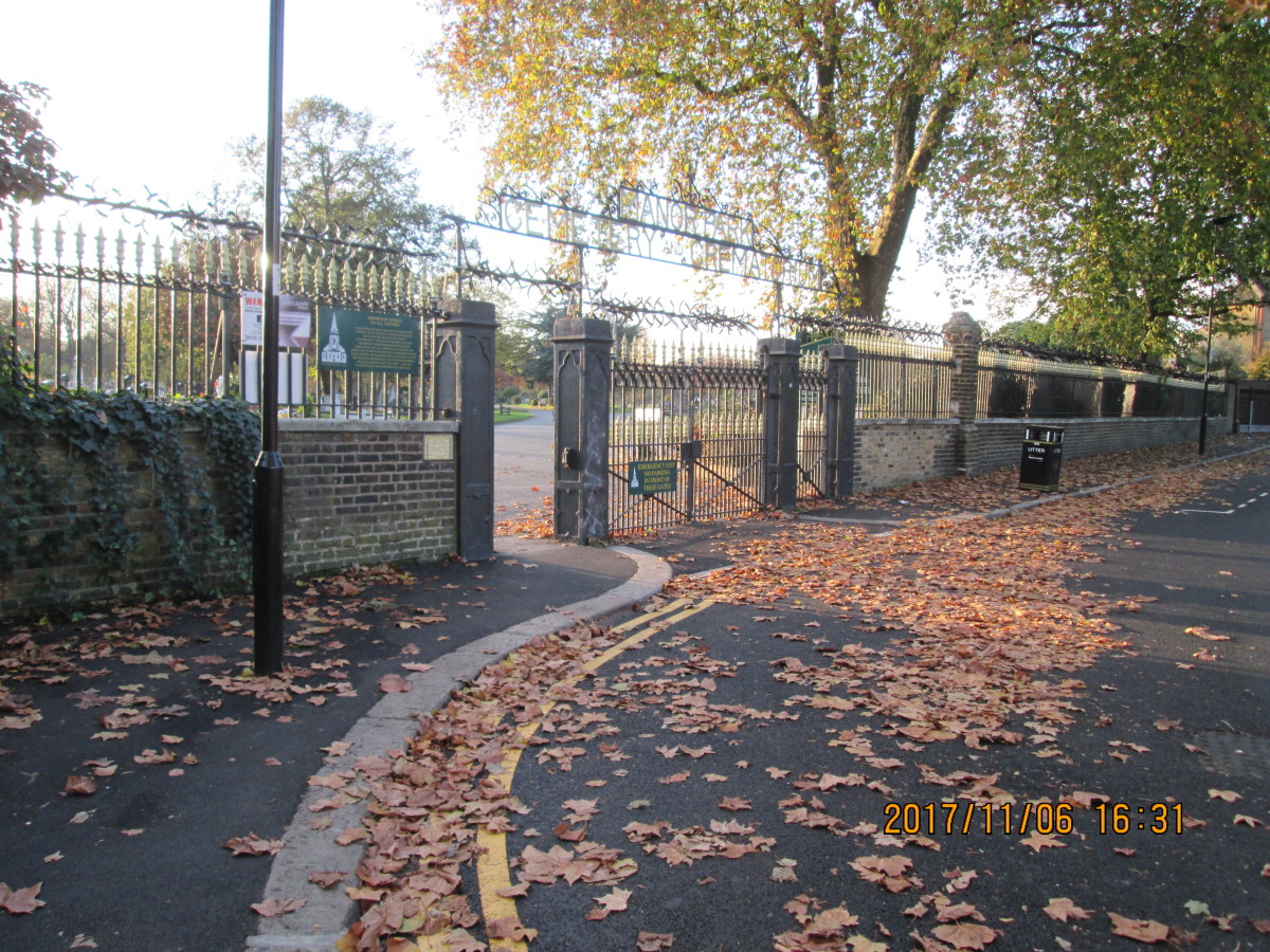 Seen from Whitta Road going east to the railway station, the iron railings and gates are well maintained, closing times posted on a board inside the cemetery