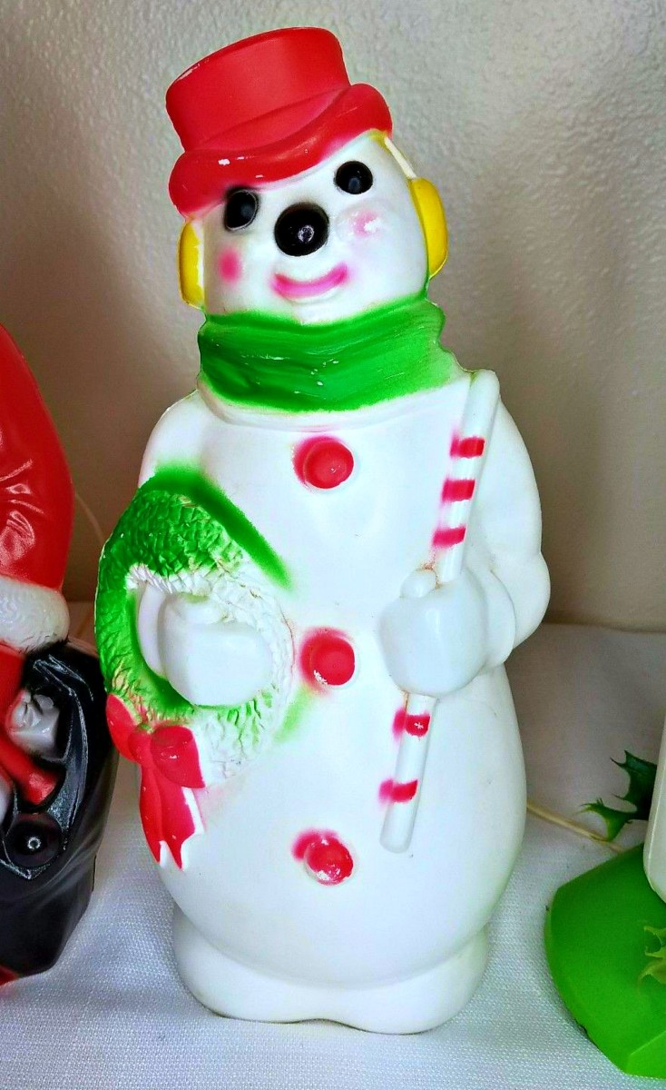 A lovely vintage 1968 Empire Plastics SNOWMAN holding his Wreath and Candy Cane, this is a mantle top indoors Blow Mold and stands thirteen inches tall.