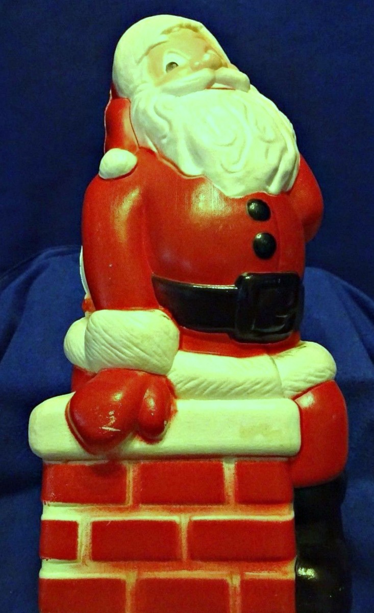 The Happy Santa Claus sitting on the chimney was made by General Foam Plastic back in the late 1960's.