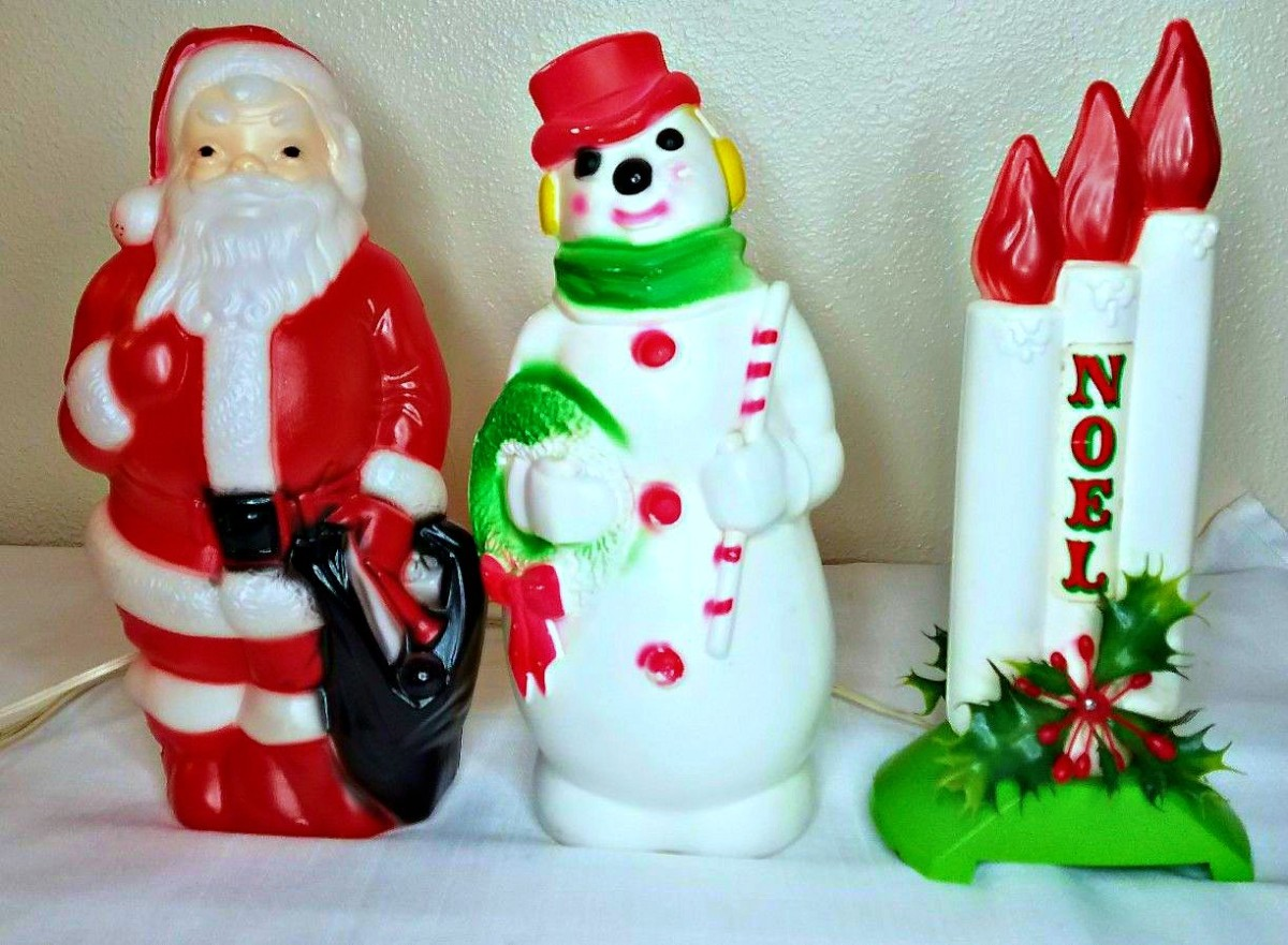 Three beautiful and well made Empire Blow Molds, Santa Claus, Snowman and a beautiful window Noel Blow Mold Candles display. They are between 13 inches tall 14 inches  tall.