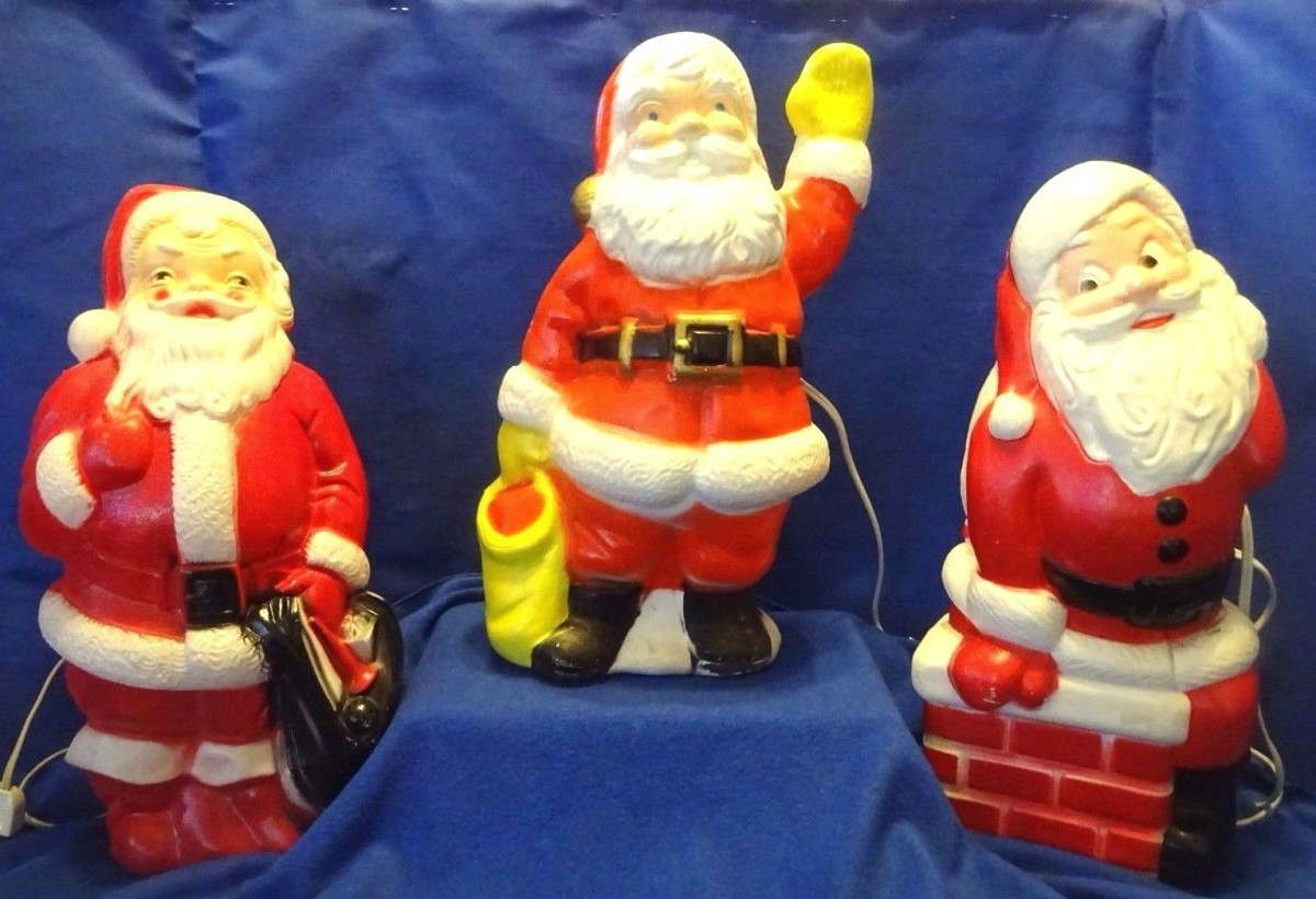 The Empire Santa has the black bag, he was made in 1968. The Santa with the yellow glove and yellow bag has no maker mark. Happy little Santa Claus sitting on the chimney is made by the world famous General Foam Plastic back in the late 1960's.