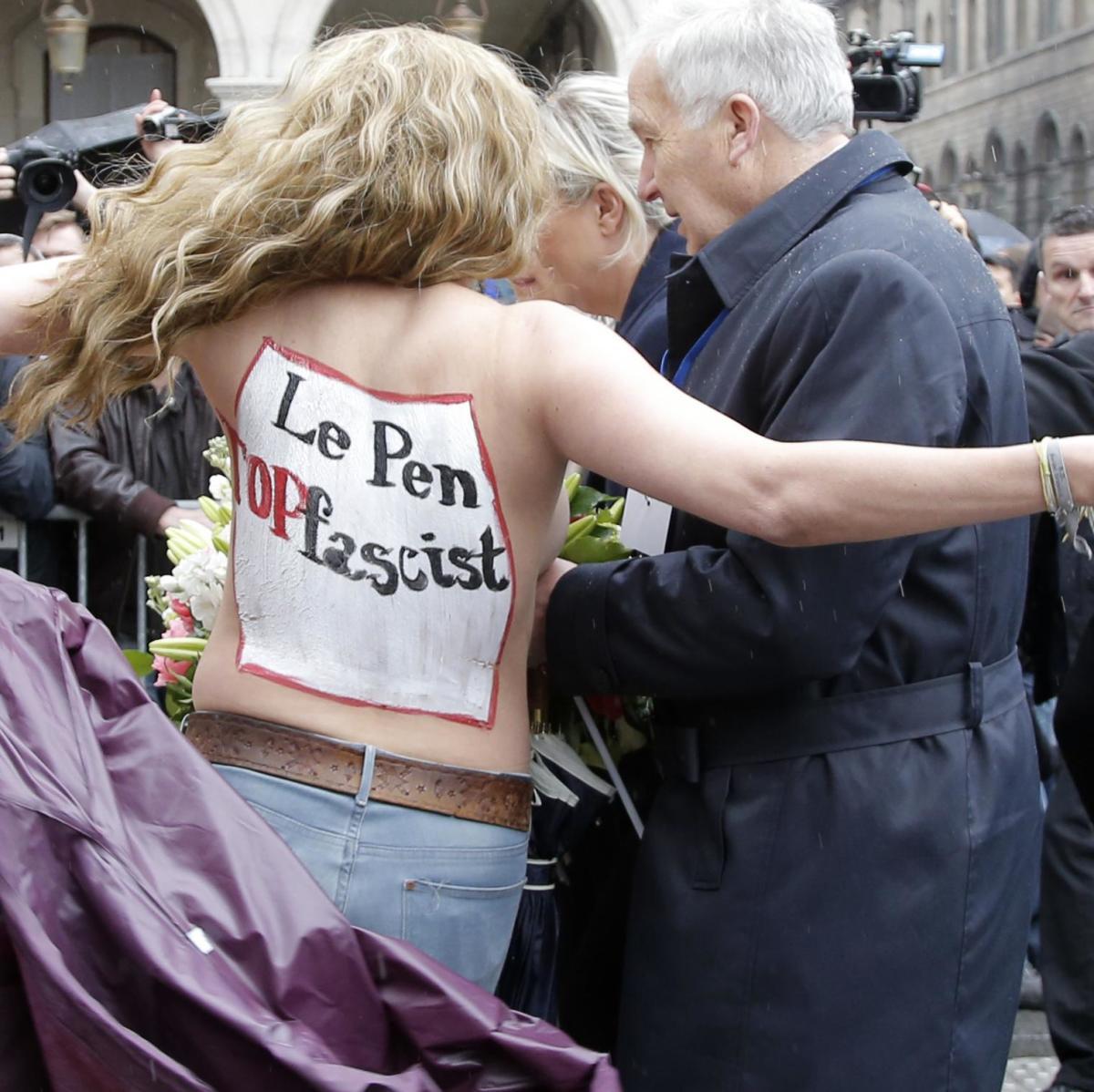 FEMEN Disrupting Marine Le Pen's May Day Speech in Paris