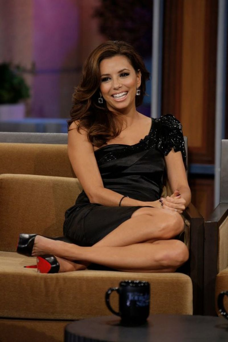Eva Longoria curled up in a chair at one of her many media appearances