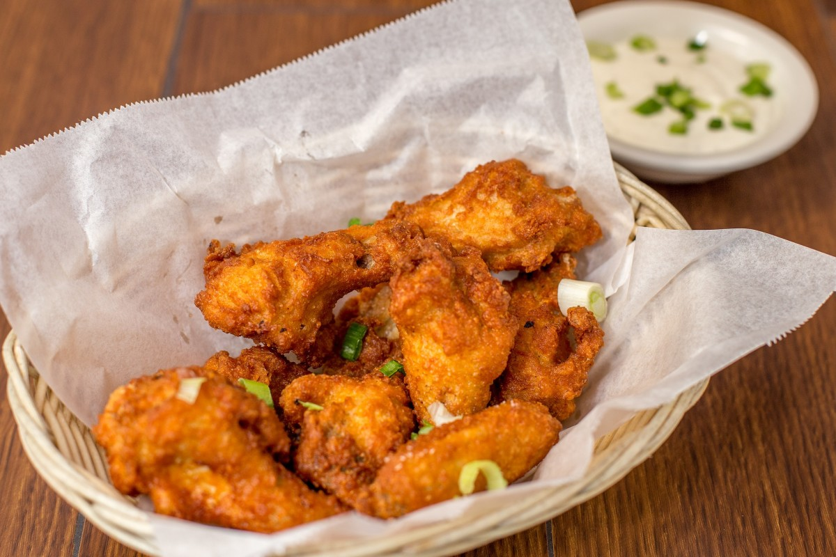 The wings were the brainchild of Teressa Bellissimo, who covered them in her own special sauce and served them with a side of blue cheese and celery because that's what she had available.