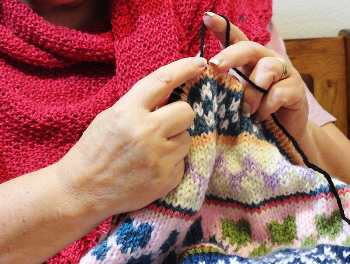 Me knitting another Fair Isle Baby Blanket
