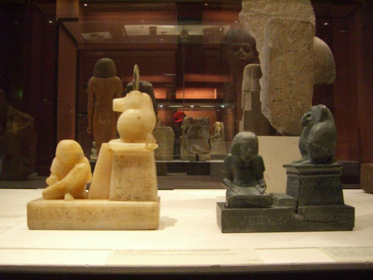Thoth statues in the Louvre. Scribes and government officials often commissioned portraits of themselves writing with the Thoth-baboon watching over them in approval: literacy was a sign of status.