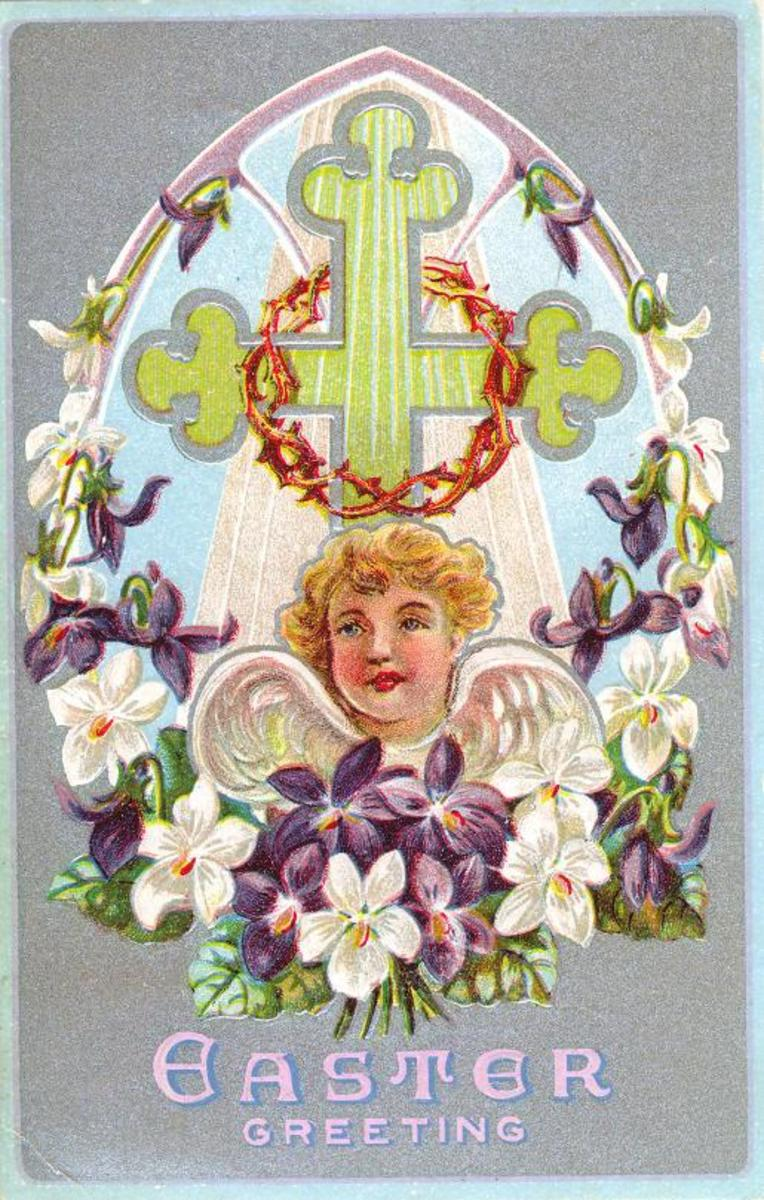 Vintage angel cross with crown of thorns and purple and white flowers