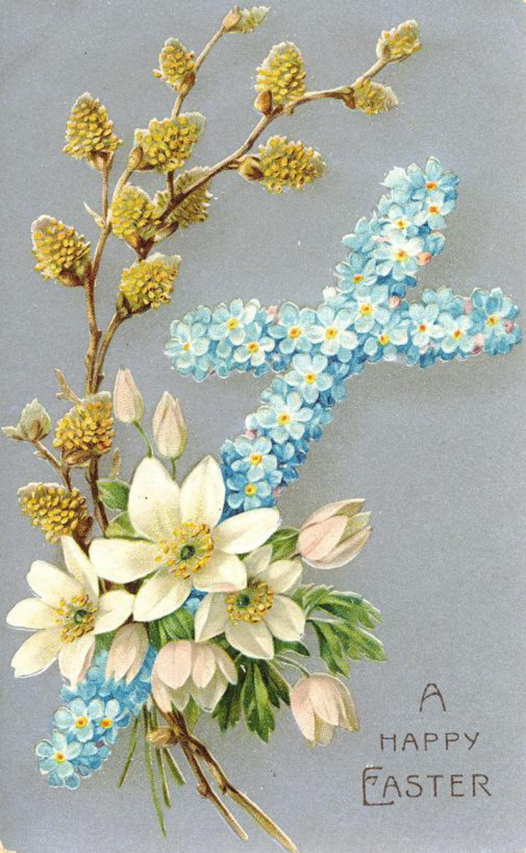 Cross made of blue flowers surrounded by white flowers