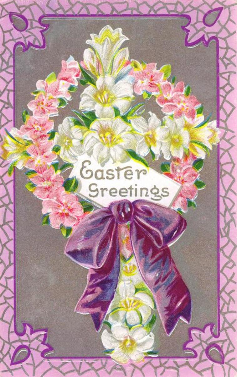 Cross made of white and yellow flowers surrounded by ring of pink flowers with purple ribbon and bow