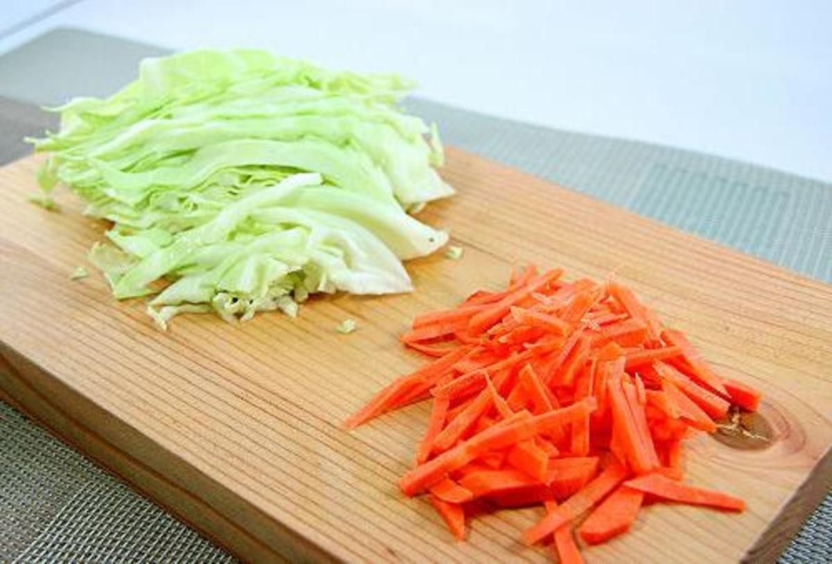 Cut your cabbage up into very thin strips. Your carrots also need to be cut into thin long strips. Make sure your strips for both are long and narrow.