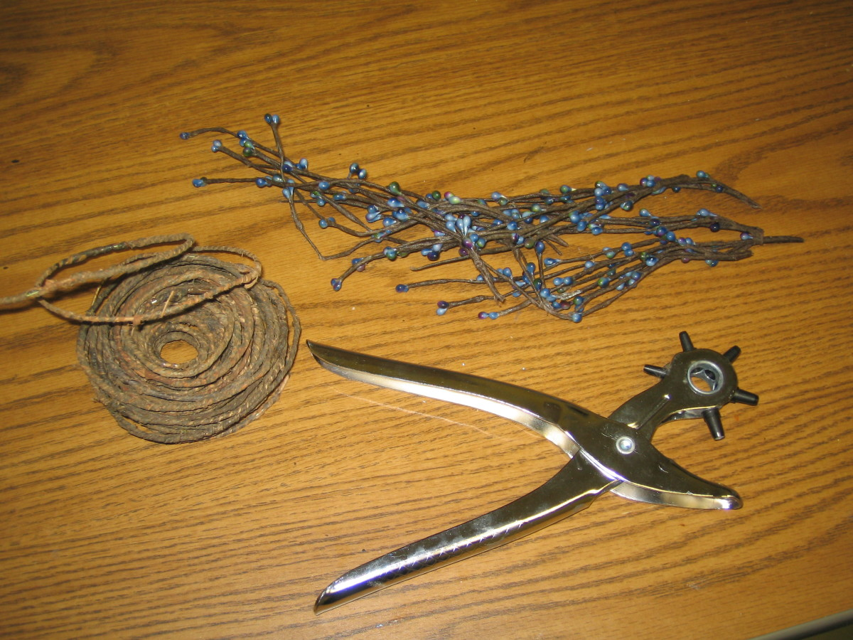 Barked covered wire, grommet hole punch, peaberry strands