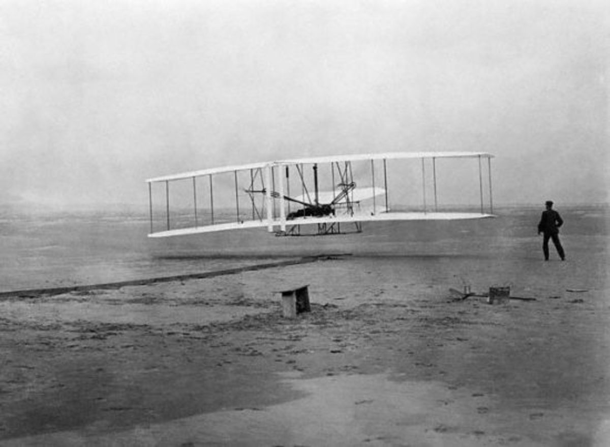 "The Wright brothers' ""Flyer"" takes to the air, 10:35 AM, December 17, 1903."