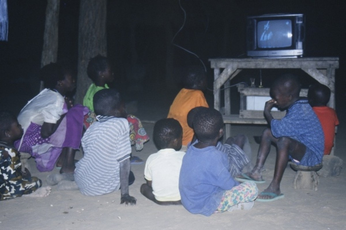 Children in Mali watch television.  Image courtesy Olivier Keite and Wikipedia.