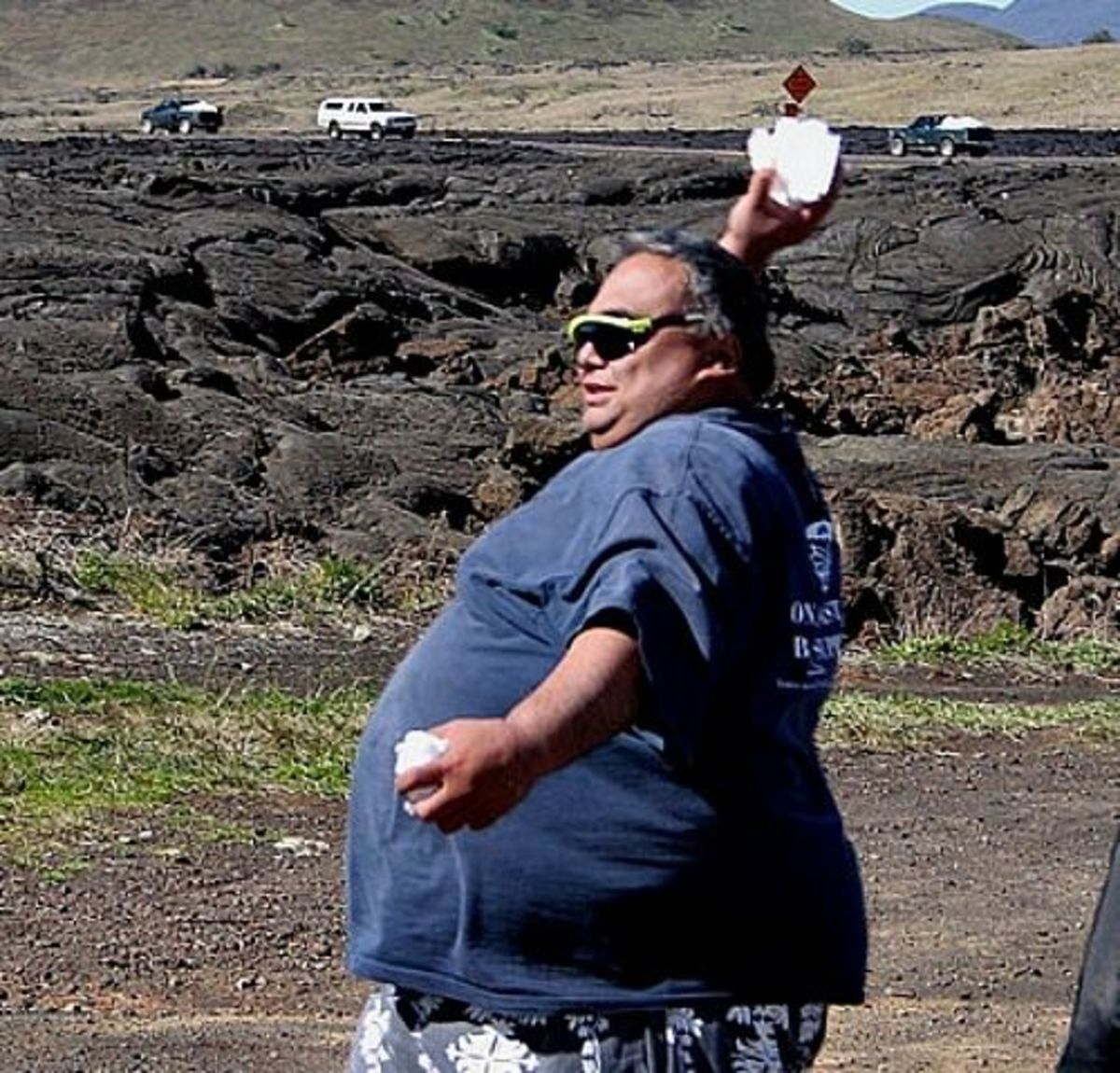 One Big Hawaiian Man Throwing a Snowball on the Beach