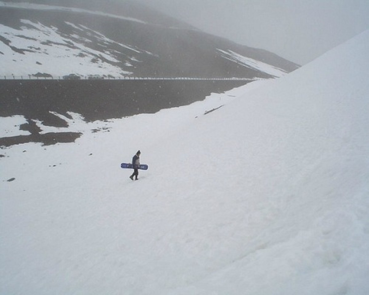 Photo of Snow Boarder Climbing up the Mountain Blizzard Conditions March 2004 by