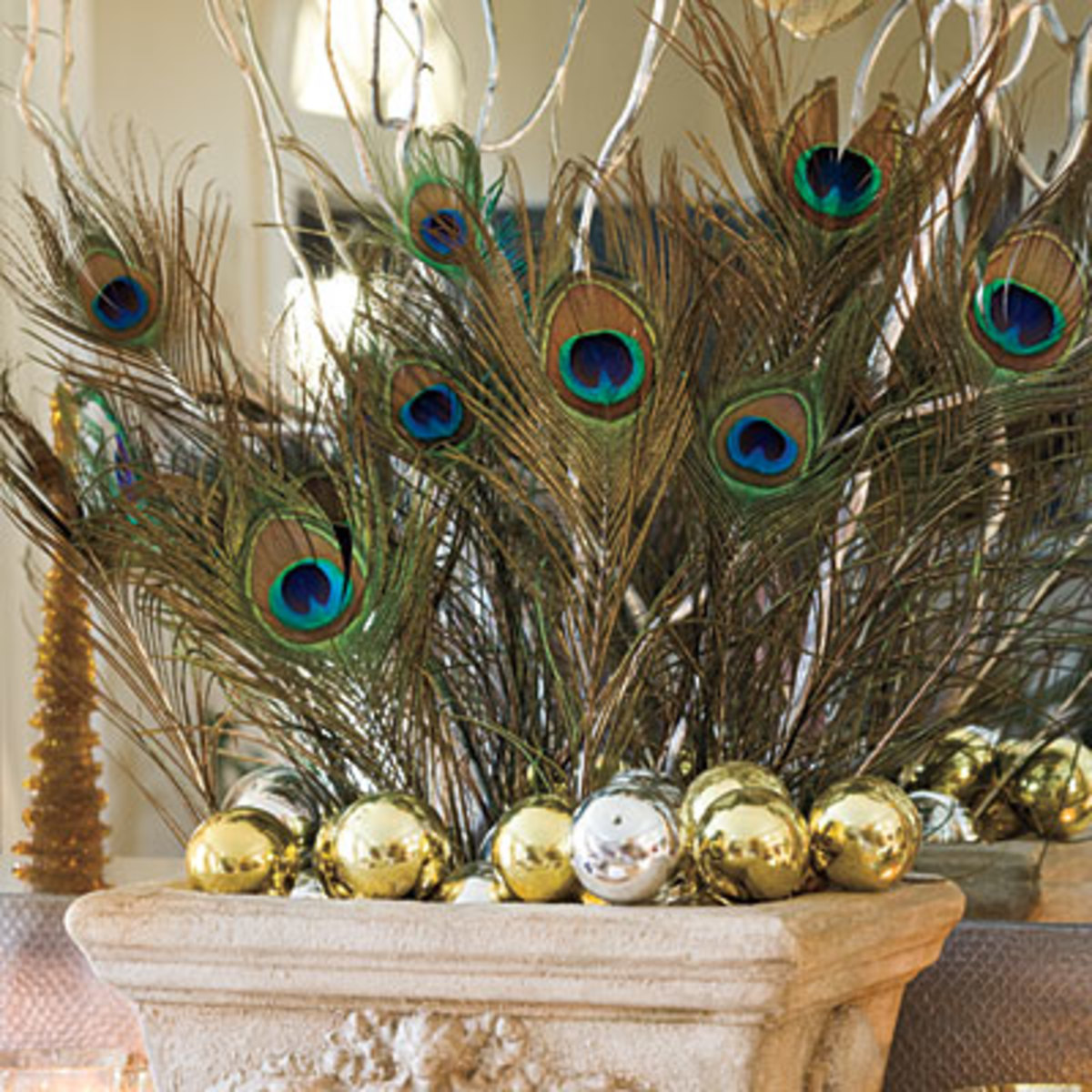 Else you can use your flower bouquet as usual but with few peacock feathers