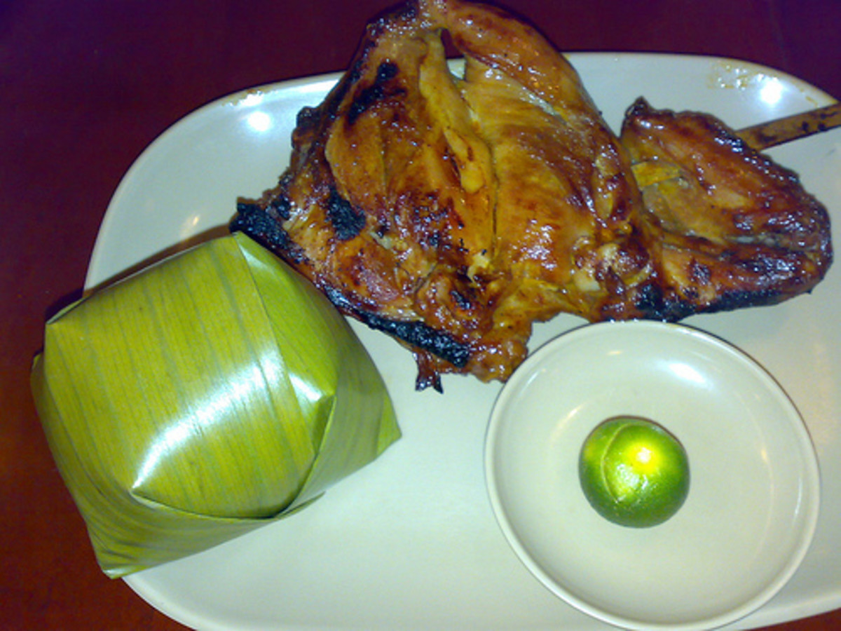 Chicken Inasal - Grilled Chicken with Steamed Rice Wrapped in Banana Leaf (Photo courtesy by whologwhy from Flickr.com)