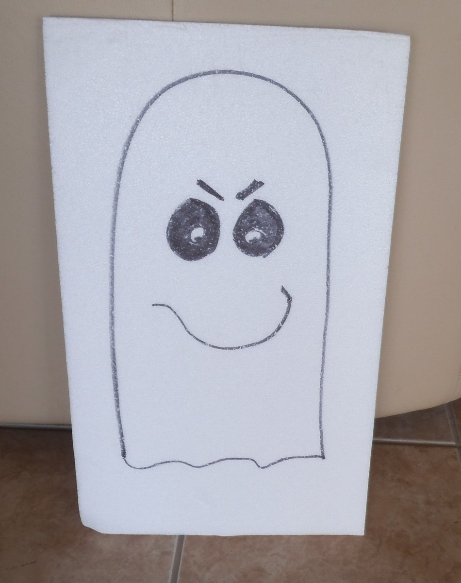 A very simple ghost with big black eyes, a curvy smile and two slashes for eyebrows. Sometimes the ghost doesn't even have a mouth just the white shape with eyes.